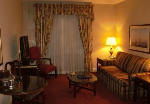 212 Sitting Room.  Dark carpet.  Flowery curtains.