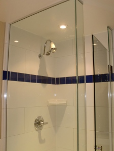 Glass shower good.  But cheaply constructed.