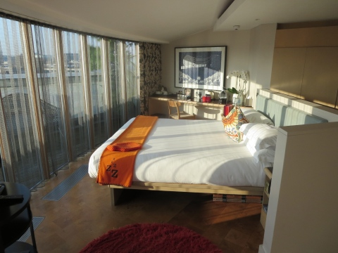 Sunny bedroom with lots of windows.