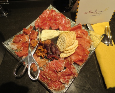 Snacks include this gorgeous charcuterie plate.