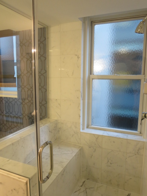 A glass shower with a view.  And a bench!  NPS is in love.