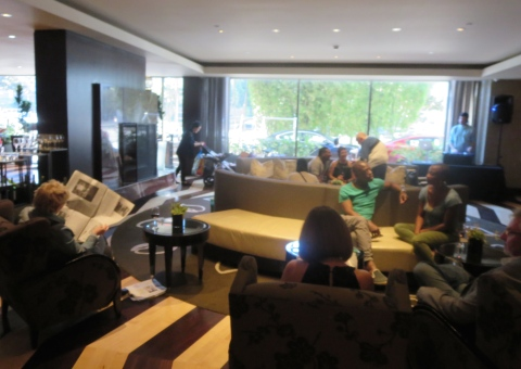 Wine hour in the packed lobby