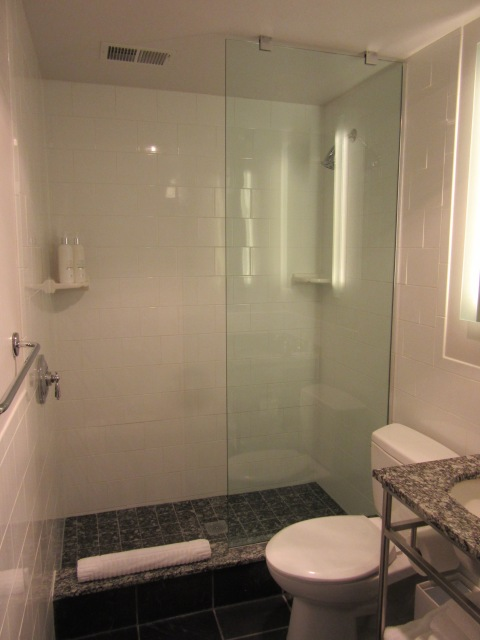 The diminutive bathroom has a glass shower, so that's good