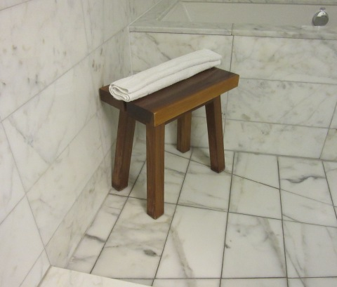 With a bench, because you NEED a bench in the shower