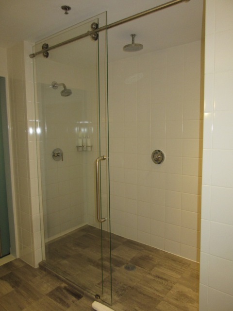A glass shower big enough for everyone!