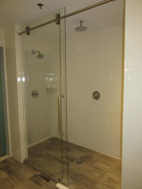 A glass shower big enough for everyone!