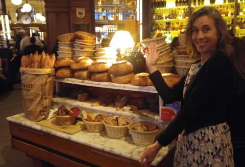 Amy strikes her best Vanna pose by the bread at Le Diplomate